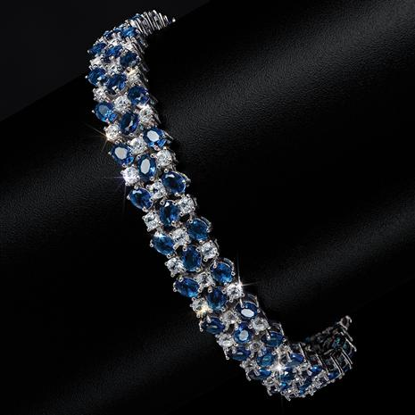 3 Row Blue Helenite and White Topaz in sterling silver bracelet